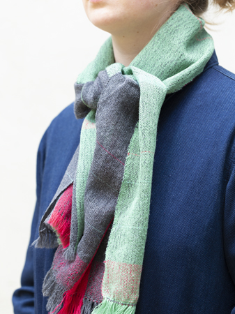 Scarf handwoven from wool in Bauhaus-inspired stripes and blocks