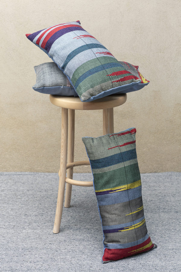 cotton ikat bright cushions on a stool